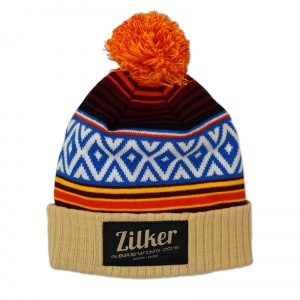 Zilker knit pom beanie with woven label patch.