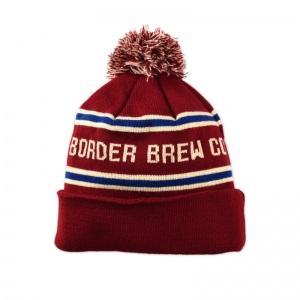 Border Brewing knit pom beanie.